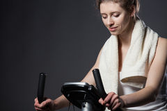 Woman on a training bicycle Stock Photos