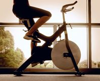 Woman training on bike Royalty Free Stock Photo