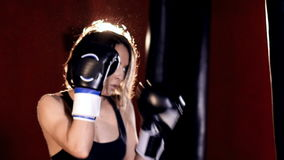 The woman training in boxing gloves. Portrait. HD. The woman training in boxing gloves. Portrait stock footage