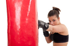 Woman training in boxing on punching bag stock photos