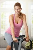 Woman training on exercise bike Royalty Free Stock Images