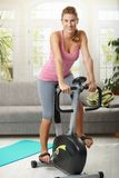 Woman training on exercise bike Royalty Free Stock Image