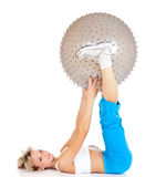 Woman training on fitness ball Royalty Free Stock Image