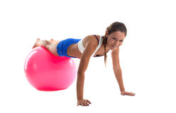 Woman training on fitness ball isolated Royalty Free Stock Images