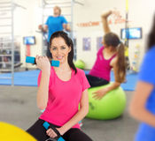 Woman training in a fitness club Royalty Free Stock Image