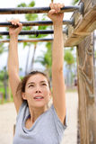 Woman training on fitness ladder monkey bars Royalty Free Stock Photography