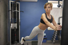 The woman is training the gluteal muscles.  stock photos