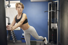The woman is training the gluteal muscles Stock Photos