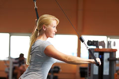 Woman training in gym Stock Images