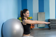 Woman training at gym with balloon Royalty Free Stock Image
