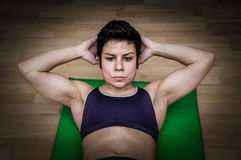 Woman training in a gym Royalty Free Stock Photos