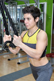Woman training in a gym Royalty Free Stock Photo