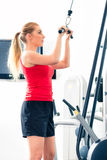 Woman training in gym or sport center Royalty Free Stock Photos