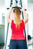 Woman training in gym or sport center Stock Images