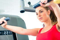 Woman training in gym or sport center Stock Photos