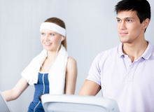 Woman training on gym training with coach in gym Royalty Free Stock Image