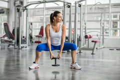 Woman training in the gym Stock Photos