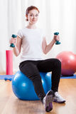 Woman training at the gym Stock Photos