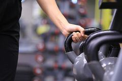 Woman training hand holding kettlebell for burn fat in the body stock photo