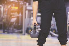 Woman training hand holding kettlebell for burn fat in the body royalty free stock photography