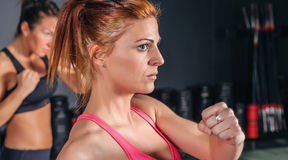 Woman training hard boxing in the gym Stock Photo