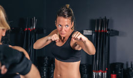 Woman training hard boxing in the gym Royalty Free Stock Image