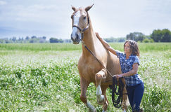 Woman training her horse Royalty Free Stock Photos