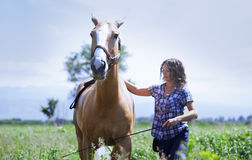 Woman training her horse royalty free stock image