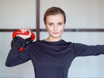 Woman training with kettlebell stock photo