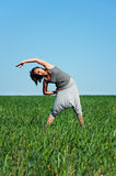 Woman training at the meadow Stock Photos