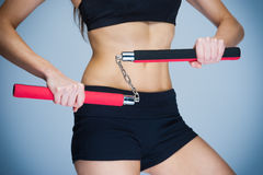 Woman Training with Nunchaku Stock Photography