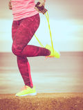 Woman training outdoor with jump rope on cold day Royalty Free Stock Photo