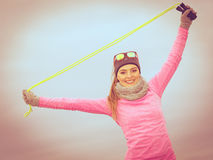 Woman training outdoor with jump rope on cold day Stock Photos