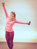 Woman training outdoor with jump rope on cold day Royalty Free Stock Images