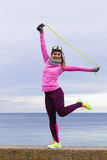 Woman training outdoor with jump rope on cold day Stock Image