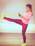 Woman training outdoor with jump rope on cold day Stock Photography