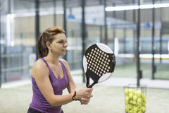 Woman training paddle tennis sport ready for hit ball Stock Photography