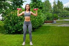 Woman training in the park stock images