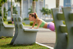 Woman Training Pectorals Doing Pushups On Street Bench-3 Stock Images