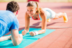 Woman training with personal trainer Royalty Free Stock Images