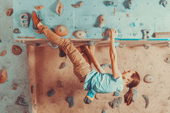 Woman training on practice climbing wall Stock Photography