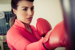 Woman training on a punching bag in the gym Stock Photo