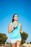Woman training for running summer marathon stock photography
