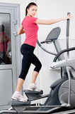 Woman on a training simulator Stock Photos