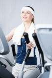 Woman training on simulators in gym Royalty Free Stock Photo