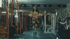 Woman training at sport gym working out with jump rope. In slow motion stock video