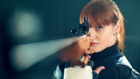 Woman training sport shooting with air rifle gun.  stock video