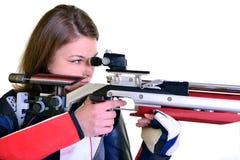 Woman training sport shooting with air rifle gun Stock Photos