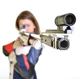 Woman training sport shooting with air rifle gun. In studio Royalty Free Stock Photography