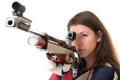 Woman training sport shooting with air rifle gun. In studio Stock Photo